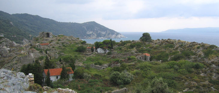 The ruins of Old Schiatto and beyond them the channel between the island and mainland Greece